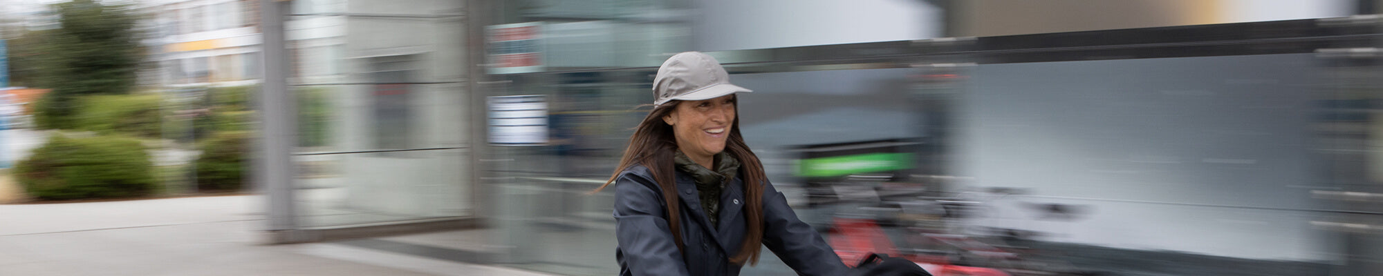womens hats banner featuring a woman wearing a sunday afternoons beanie