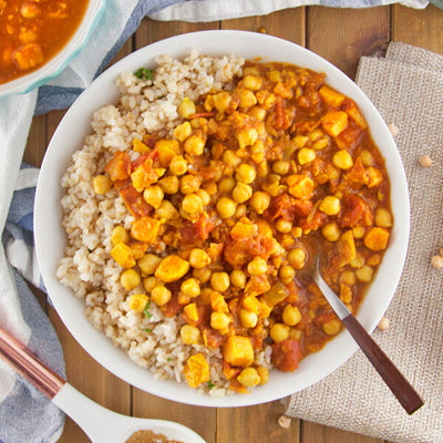 Spicy Indian Chana Masala with Sweet Potatoes Over Herbed Brown Rice-square view