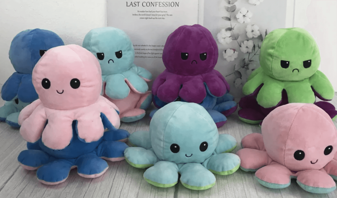 Soft toys for children are octopus who smile and are happy.