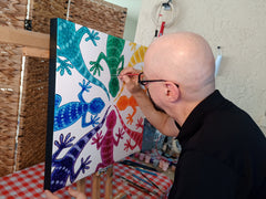 One of our artists, Arnie L, putting the finishing touches on the original Circle of Geckos