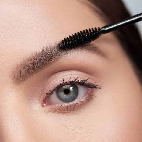 A closeup photo of a person applying The Simple Brow