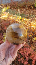 Load and play video in Gallery viewer, Golden Quartz Polished Sphere from Madagascar