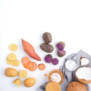 Collection of ingredients, sweet potato and purple potatoes, plus coconut oil and sea salt carousel thumbnail image