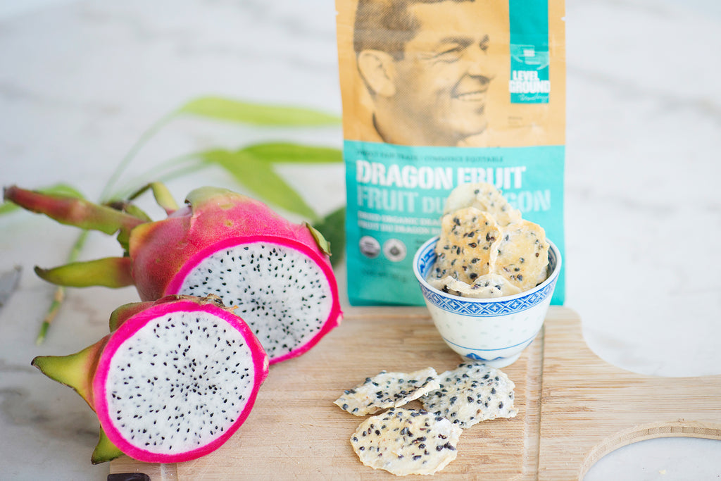 Dried and fresh dragon fruit and package on wooden cutting board