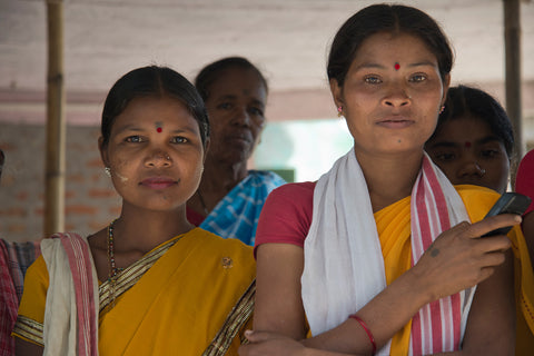 Female tea workers stand together