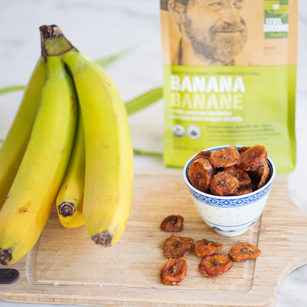 Organic dried banana, 130 gram package, fresh banana on cutting board