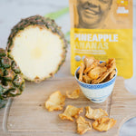 Organic dried pineapple, 100 gram package, fresh pineapple on cutting board