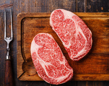 Load image into Gallery viewer, 100% Full Blood Japanese Black Wagyu ground beef. This comes from a cow that is rated as an A4 grade on on the IMF scale. Our exclusive Umami Wagyu cattle that we have partnered with Prime Valley Ranch with are grain fed for 600 days and raised in the traditional Japanese method.  Our Ribeye Steak are hand cut with a weight range of 10 - 12 oz with an average of 11 oz per steak.
