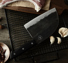 Load image into Gallery viewer, When you need a Big Heavy knife that will cut thru Chicken bones no problem but slice a tomato paper thin, this beast is for you. It is heavy and makes cutting almost anything feel like slicing thru butter.  Projama , crooked butcher