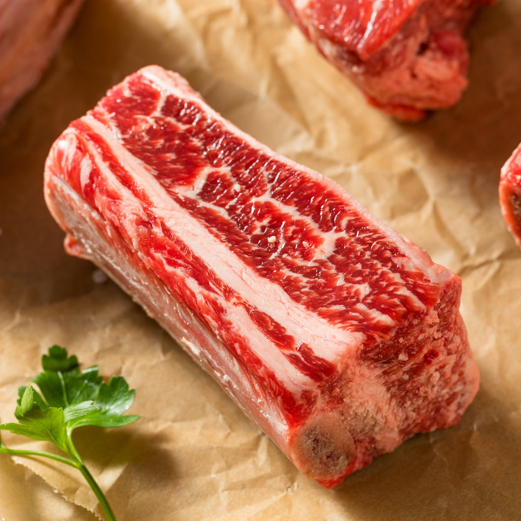 Beef Short Ribs are cut from the lower portion of the rib cage and have a nice thick layer of fat-laced meat on top of the bone. These Short ribs are cut into individual size bones and are perfect for slow cooking such as braising or on the grill or smoker. The Crooked Butcher