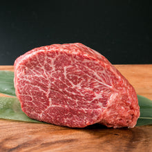 Load image into Gallery viewer, 100% Full Blood Japanese Black Wagyu ground beef. This comes from a cow that is rated as an A4 grade on on the IMF scale. Our exclusive Umami Wagyu cattle that we have partnered with Prime Valley Ranch with are grain fed for 600 days and raised in the traditional Japanese method.  Our Strip Steaks are hand cut with an average weight of 6 oz per steak.