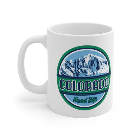 Front view of white mug with Colorado road trip logo