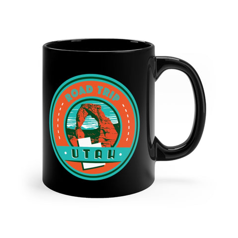 Front view of black mug with Utah Road Trip logo
