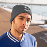 Man wearing gray beanie with Scenic Hwys logo embroidered on front