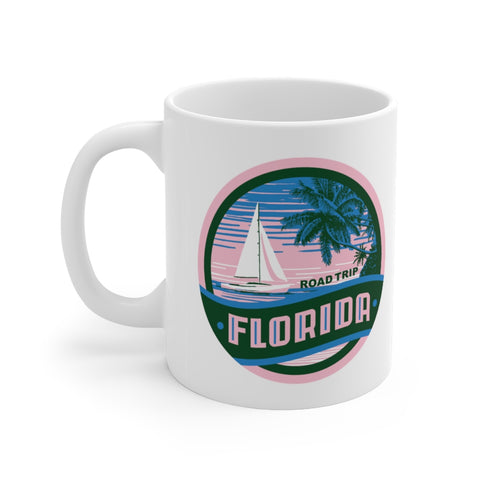 Front view of white mug with Florida Road Trip logo