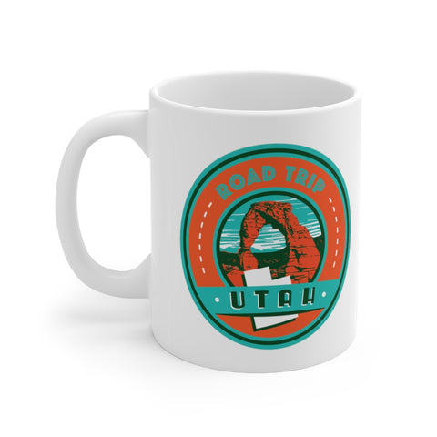 Front view of white mug with Utah Road Trip logo