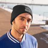 Man wearing black beanie with Scenic Hwys logo embroidered on front