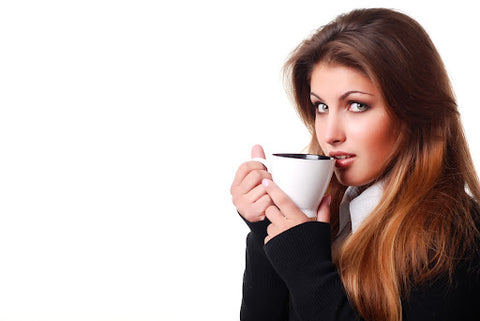 Before You Drink Kava …, Woman holding a mug of kava after taking a sip.
