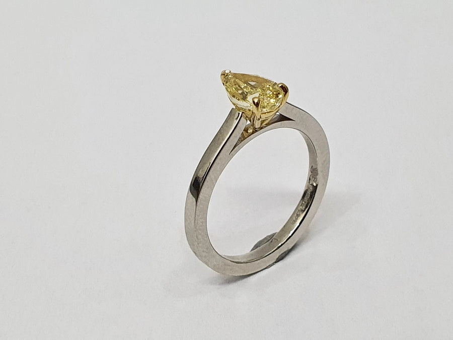 A stunning Natural Fancy Yellow Pear Shaped Diamond set in an 18 Carat Yellow Gold setting and a Platinum Band