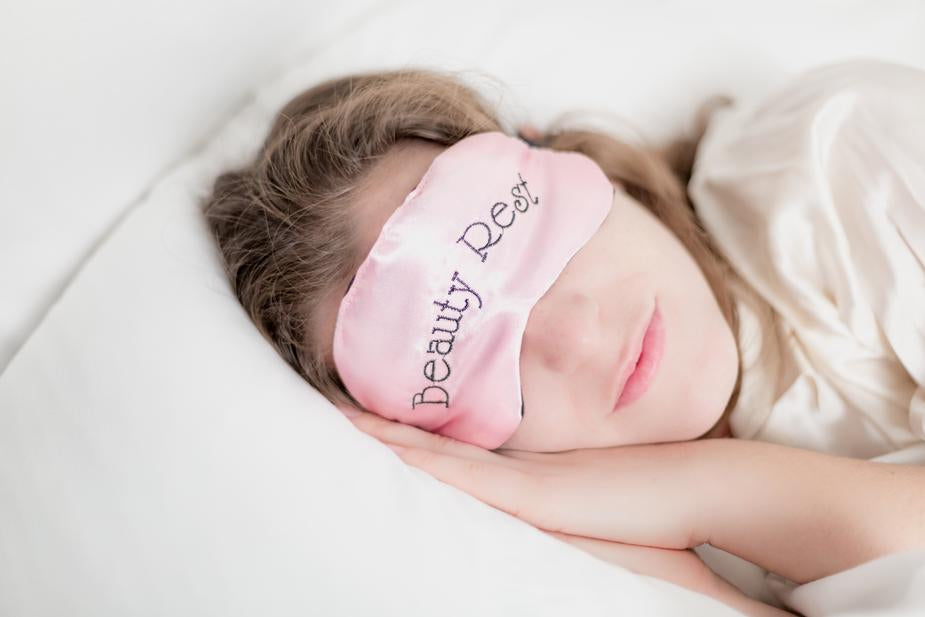 Woman with silk sleep mask