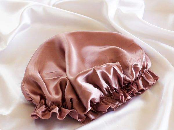 Silk sleep bonnet in deep blush pink