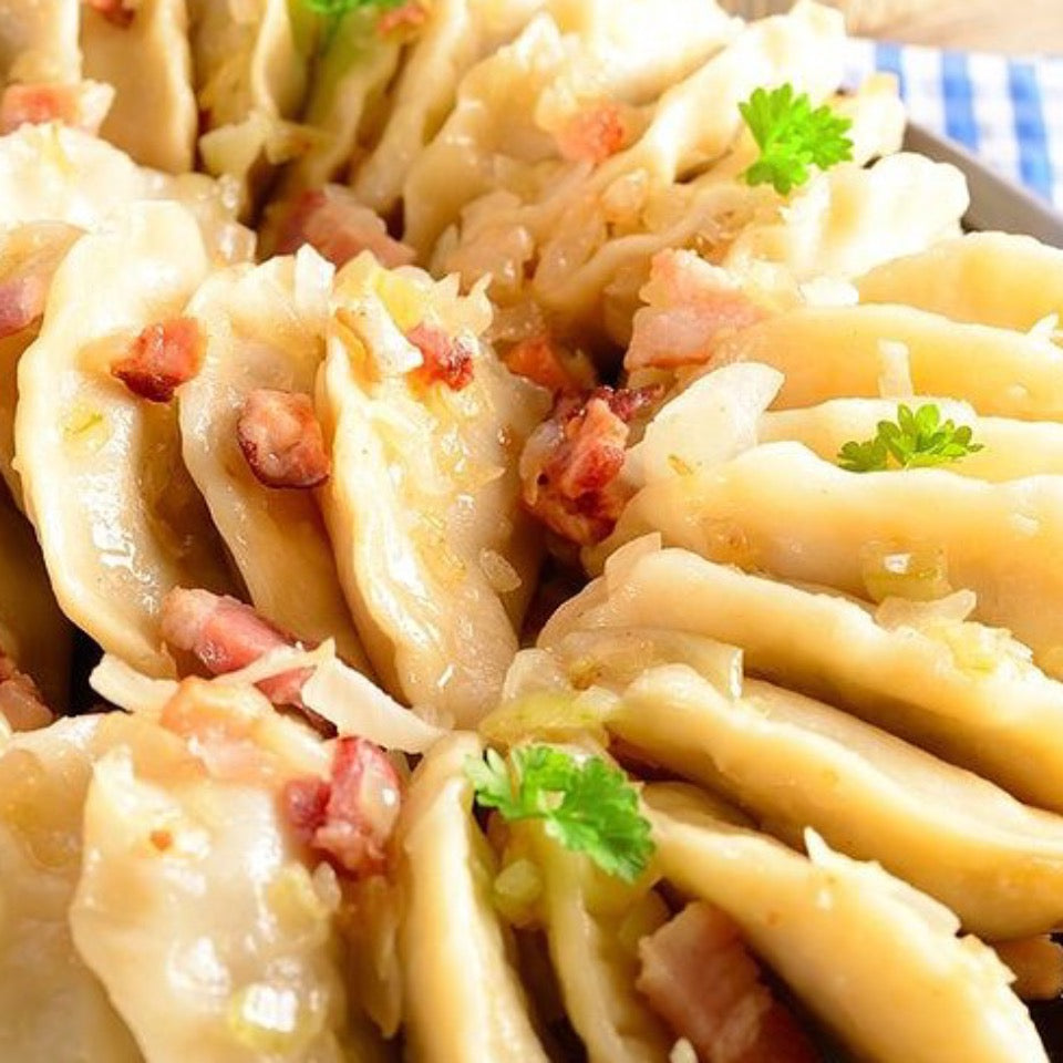 cooked classic pirogies with crumbled bacon