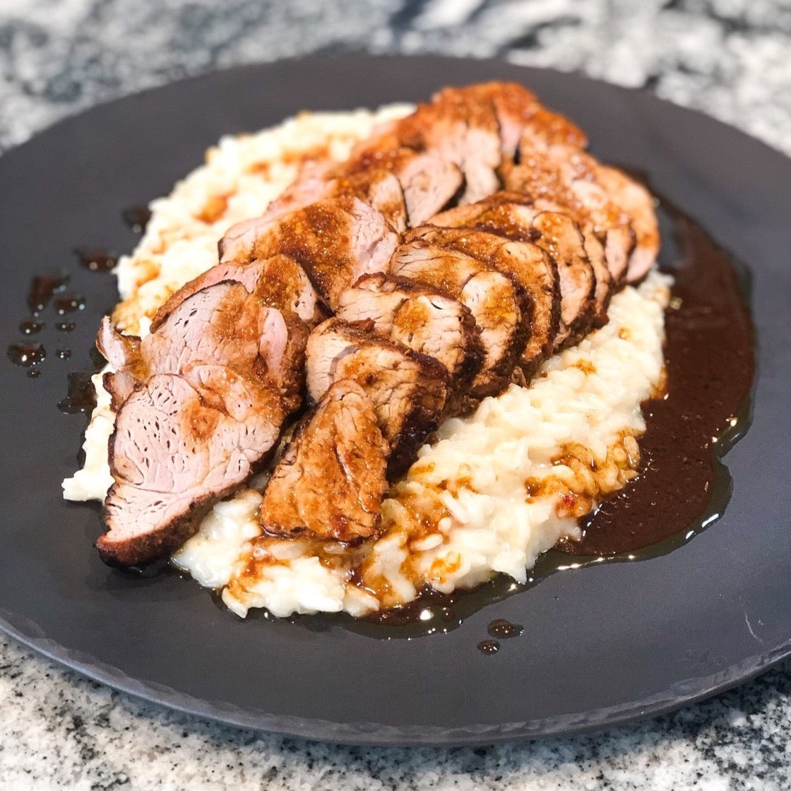 cooked Korean bbq pork tenderloin over risotto