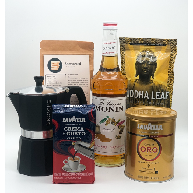 Espresso yourself box including stovetop espresso maker, shortbread baking kit, monin flavour syrup, 2 ground coffees and a bag of loose leaf citrus relaxer tea
