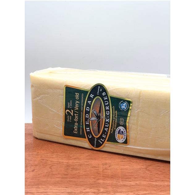 brick of aged white cheddar cheese