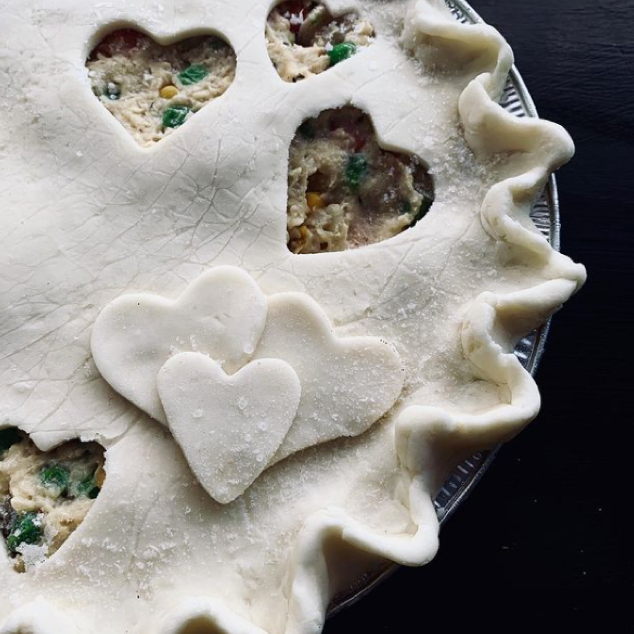 uncooked chicken pot pie with hearts on crust