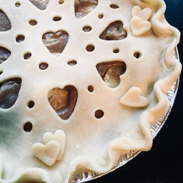 uncooked apple pie with hearts on crust