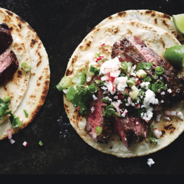 cooked carne asada tacos with queso fresco