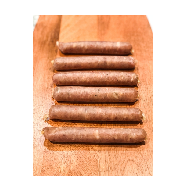 6 uncooked turkey breakfast sausages on cutting board