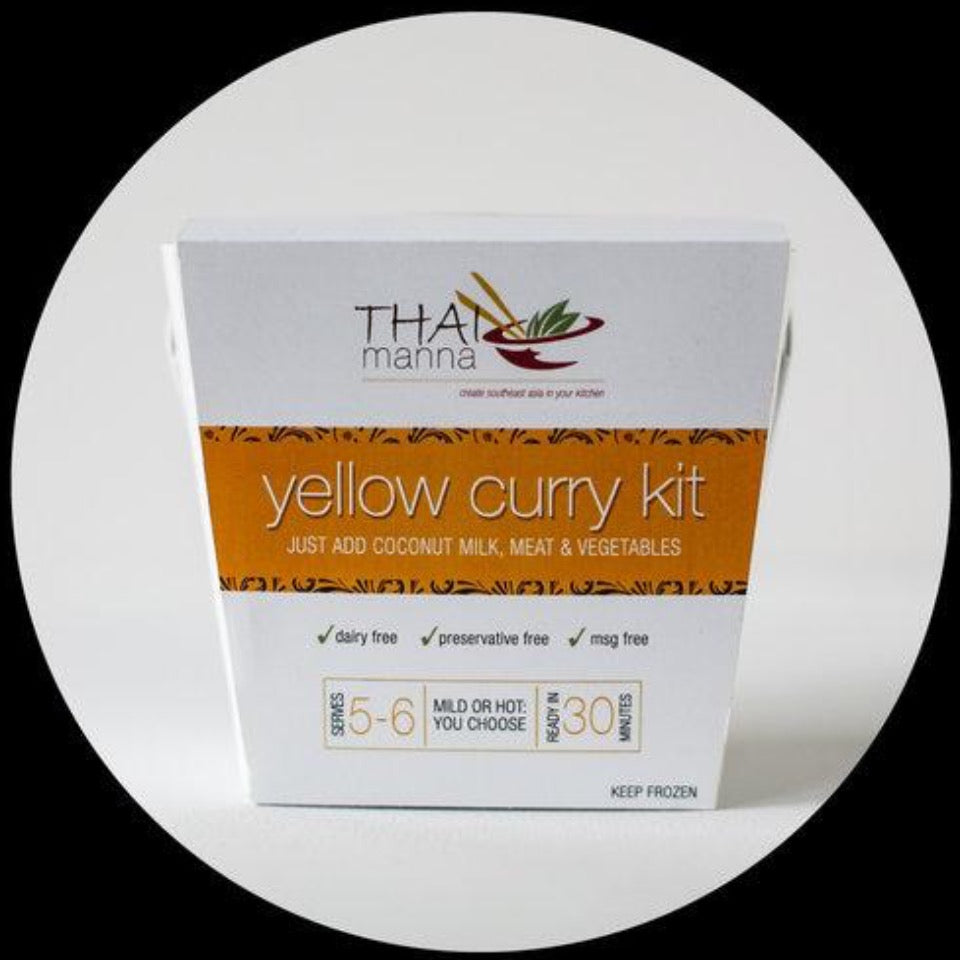 large yellow thai curry kit in takeout box
