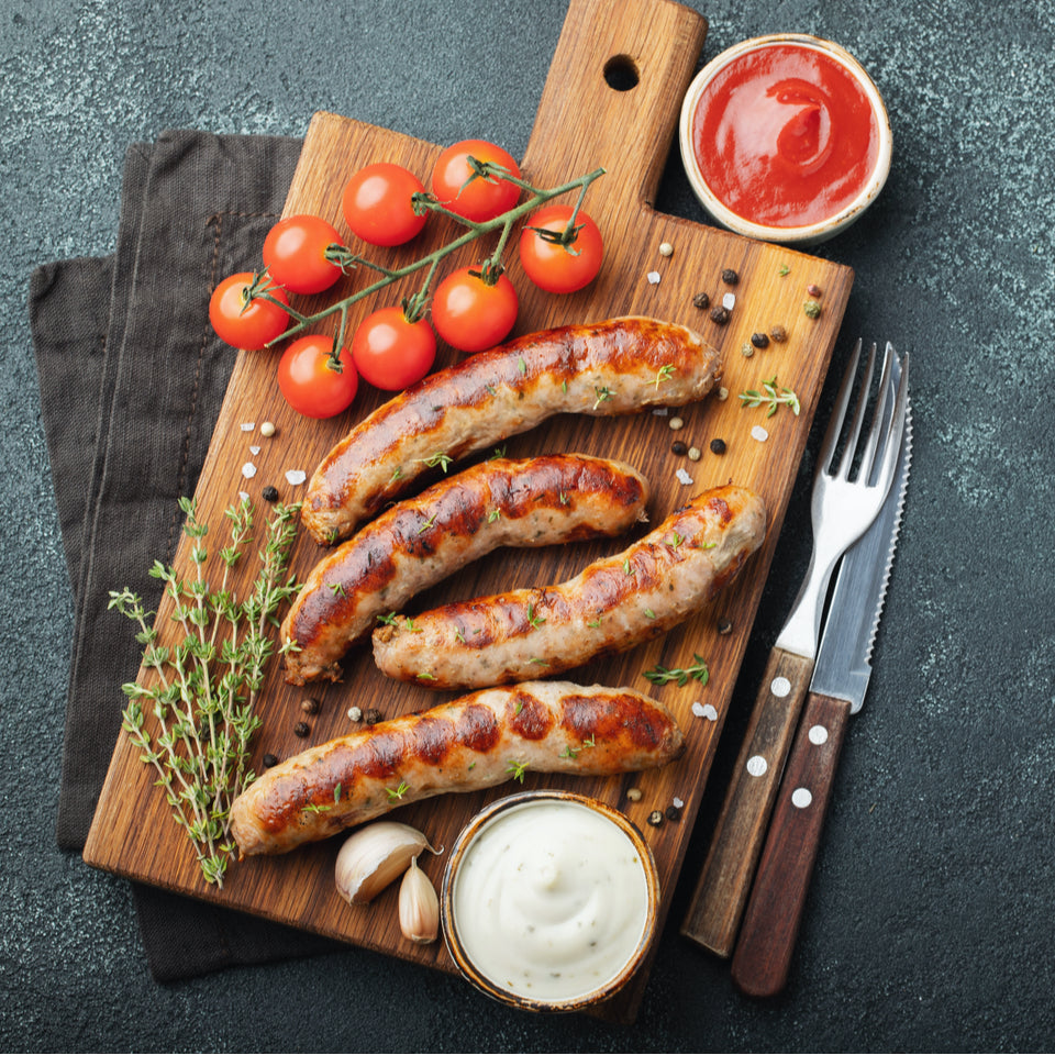 grilled chicken Italian sausages on cutting board