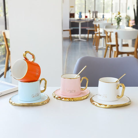 Blue, White, Pink and Orange Inspirational Coffee Cups outlines on a table