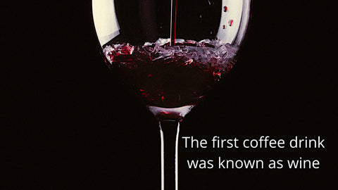 A wine glass stating that coffee was first a wine drink.
