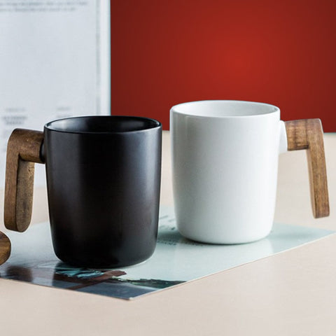 Nordic Ceramic Wooden Handle Black and White Mug on a table