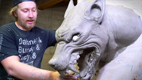 Tom Cassidy sculpting and painting at Distortions Unlimited