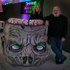 Distortions Unlimited owners Ed and Marsha Edmunds stand with the Zombie Podium at Monster World.