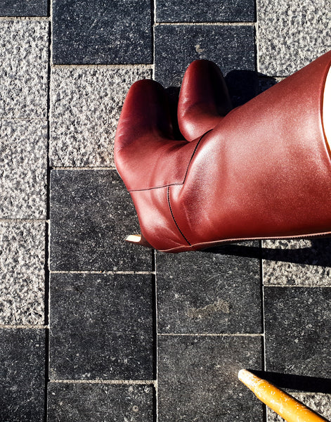 Burgundy high heeled boots