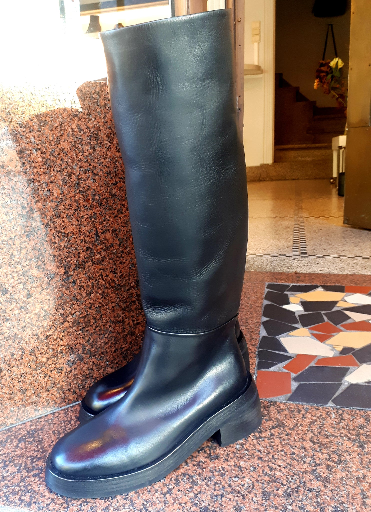 Knee high boots in black leather