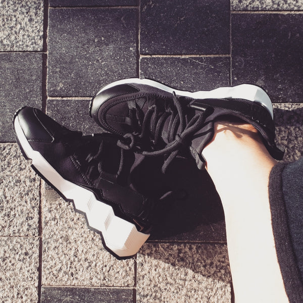Designer sneakers in black leather & neoprene