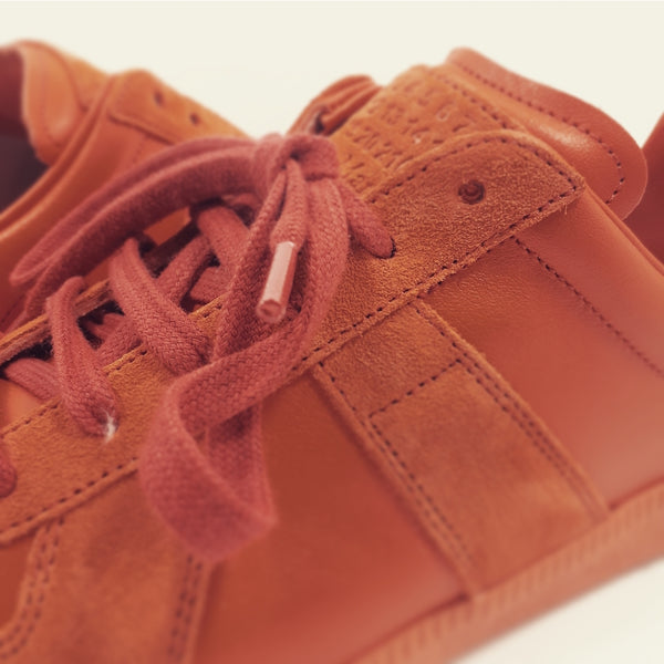 Replica runner in earthy orange