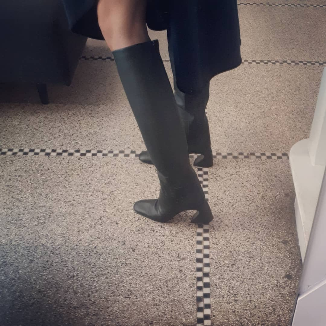 Knee high boots in dark green