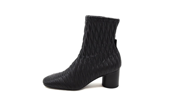 Ankle boots in black matelassé leather