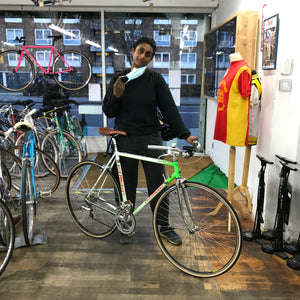 another customer with her first bike in London her stunning Moser is just one of the many lovely steel classic vintage road bikes on offer as she is standing in a shop floor full of lovely bicycles in London