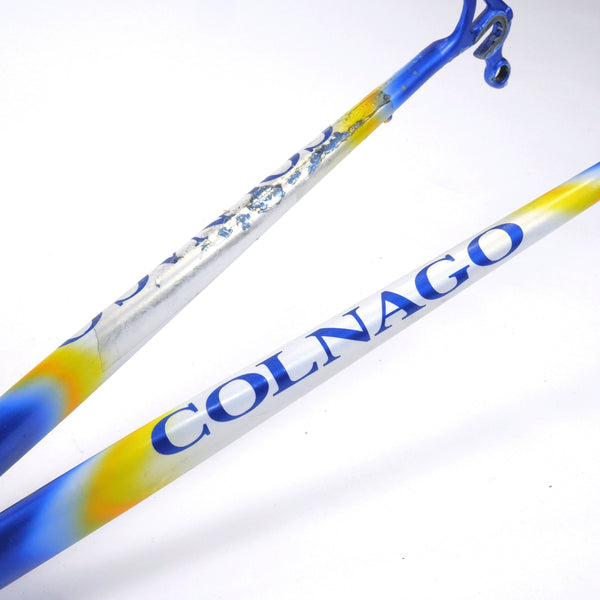 A Colnago Mapei Team frame, in blue and white, close up shot of some damage on the forks