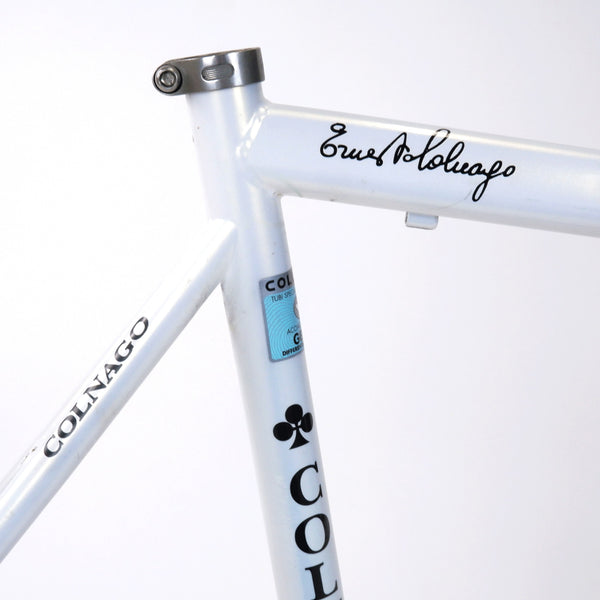 A Colnago Mapei Team frame, in blue and white, up close seat clamp