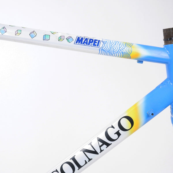A Colnago Mapei Team frame, in blue and white, up close angle of the top tube and down tube